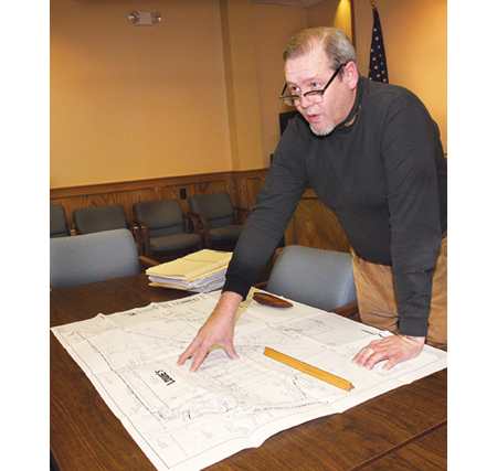 Planning director Rick Hanley looking over Lowes' site plan for the former Suffolk Life building on Route 58 in 2009. (Credit: Barbaraellen Koch)