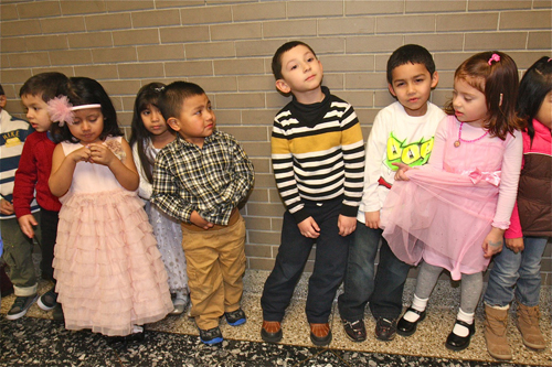 BARBARALLEN KOCH PHOTO  |  The Southampton Head Start 3- and 4-year olds waited nervously in the hall outside Riverhead High School's auditorium for the show to start Friday evening.