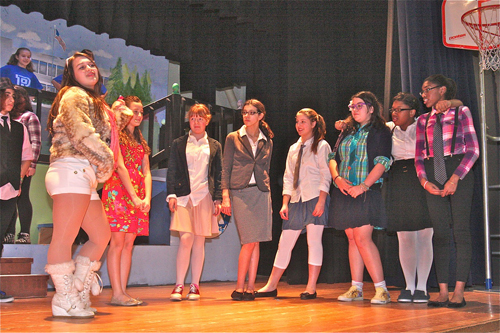 """HIgh School Musical' Drama Club president Sharpay Evans played by Kierra Prentiss (far left) and 'new student' Gabriella Montez played by Marissa Murgolo (second from left) in the opening scene."