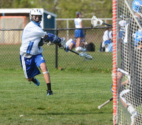 ROBERT O'ROURK PHOTO  |  Riverhead sophomore Ryan Hubbard fires a shot on goal against Middle Country Friday.
