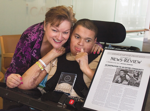 Nancy Reyer and her son Michael Hubbard with 2013 'Person of the Year' award. (Credit: Barbaraellen Koch file)