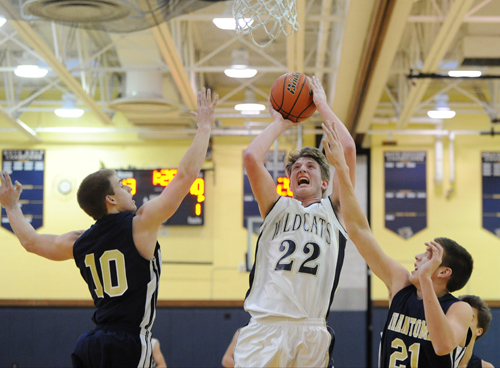 ROBERT O'ROURK PHOTO  |  Shoreham-Wading River junior Danny Hughes scored 27 points in a win over Bayport-Blue Point Friday.