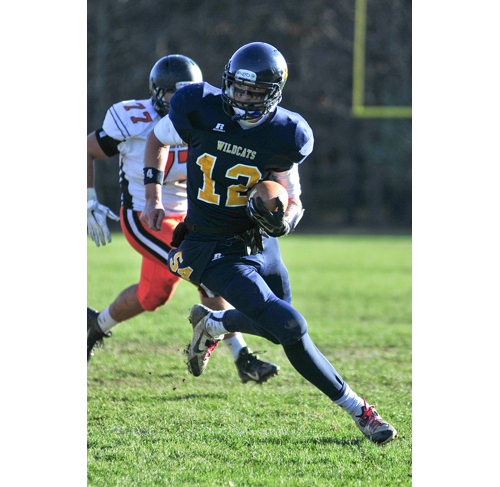 Shoreham-Wading River quarterback Danny Hughes carries the ball in Saturday's win over Babylon. (Credit: Bill Landon)