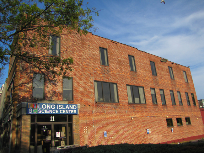 The Long Island Science Center building on West Main Street will be demolished. Photo by Tim Gannon