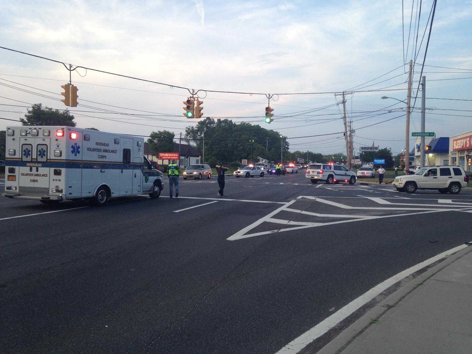 Riverhead police and fire officials at the scene on Route 58 on Monday. (Credit: Nicole Smith)