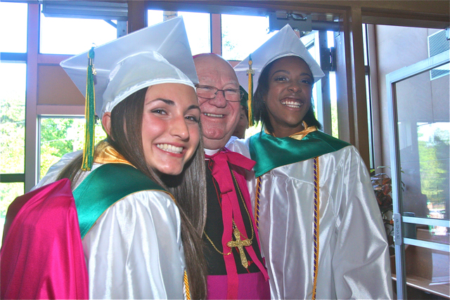 Meghan Bossone (left) and Adafih Blackburn (right) pose for a photo with Bishop William Murphy. (Credit: Barbaraellen Koch)