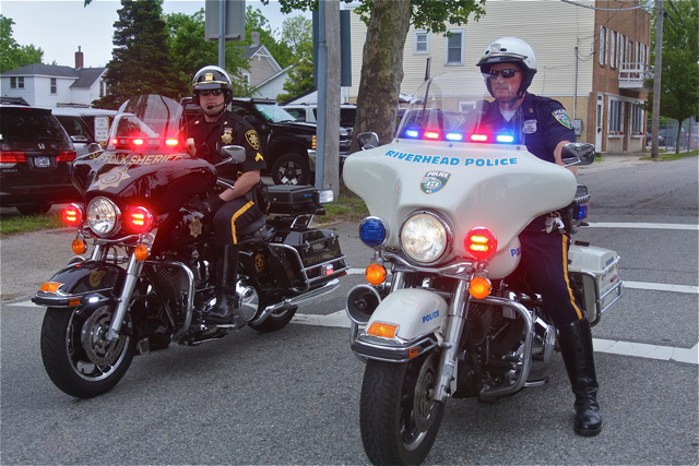 Riverhead Highway Patrol Officer Dennis Cavanaugh (right) was last year's honored guest and led the march Friday morning. (Credit: Barbaraellen Koch)