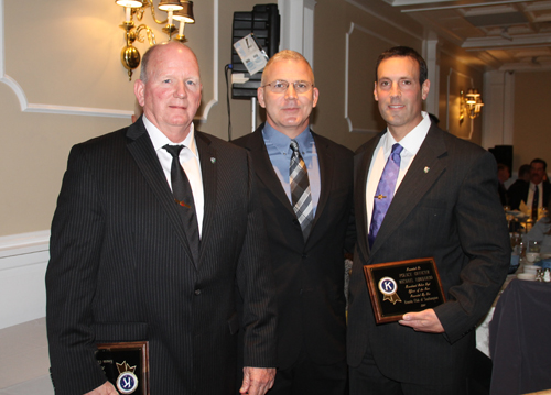 PAUL SQUIRE PHOTO | Officer Dennis Cavanagh (left) and Michael Lombardo (right) stand with Captain Richard Smith after winning the Riverhead police department's Officer of the Year awards.