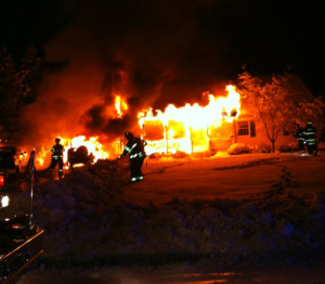 WADING RIVER FIRE DEPARTMENT COURTESY PHOTO | Firefighters combat the fire that destroyed the Dalecki family's home on Michael Lane.