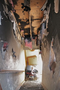 PAUL SQUIRE PHOTO | The view down the stairs of the fire-damaged home in Wading River.