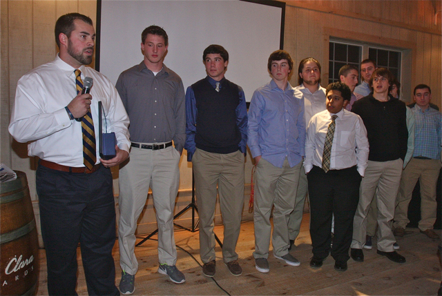 Shoreham-Wading River football coach Matt Millheiser accepts the 2014 News-Review People of the Year award on behalf of the team. (Credit: Barbaraellen Koch)