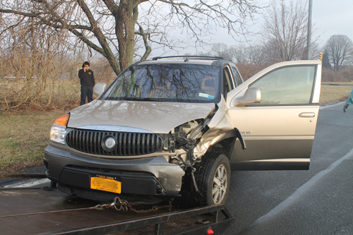 PAUL SQUIRE PHOTO | One person suffered minor injuries in a two-car crash on Route 105 Wednesday morning.