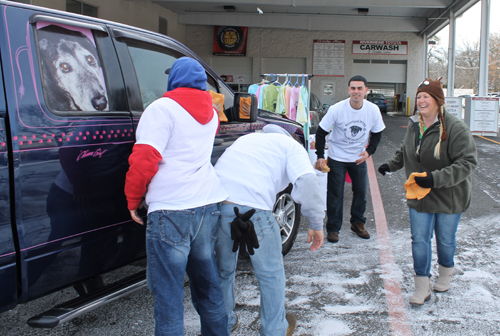 PAUL SQUIRE PHOTO | (L-R) Joel Neumann, Charles Puglisi and Joseph Luck of Absolute Detailing help clean a car with MTAS founder Denise Lucas Sunday morning.