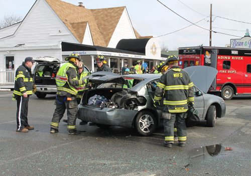 PAUL SQUIRE PHOTO | A woman was injured when she rolled out of this Saturn Ion after it was hit by a Jeep.