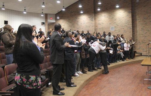 PAUL SQUIRE PHOTO | Demitri Hampton's friends and family give a standing ovation for his mother, Juanita Trent, during Monday's memorial service.