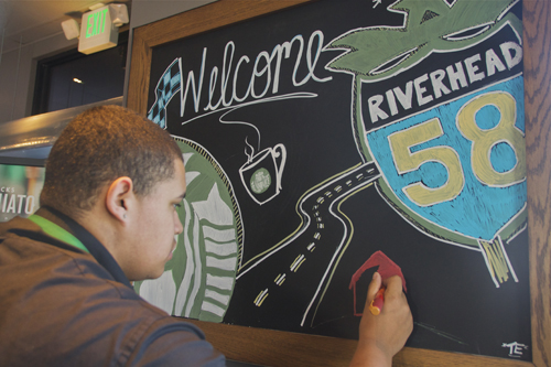 Tom Edler from Riverhead finishes up a chalkboard drawing at the Starbucks on Route 58. (Credit: Paul Squire)