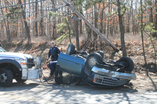PAUL SQUIRE PHOTO | A man was hospitalized Tuesday afternoon in a rollover accident in Calverton, police said.