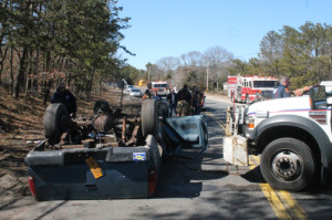PAUL SQUIRE PHOTO | Suffolk County police emergency teams work to flip the wreck over Tuesday afternoon.