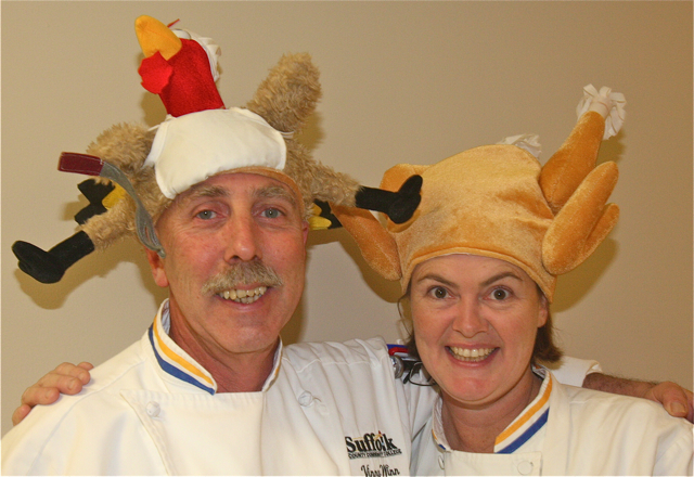 Chef instructors Vinny Winn and Andrea Glick get in the holiday spirit with their head gear. (Credit: Barbaraellen Koch)