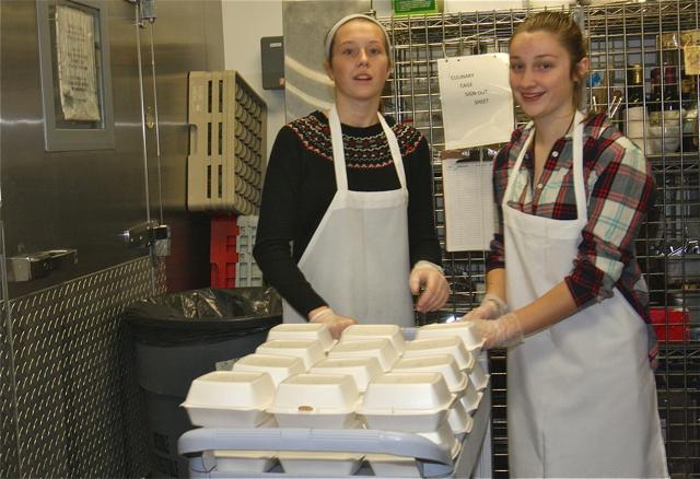 Westhampton Beach High School sophomores Reilly Gwinn and Bronte Merrell volunteered in the kitchen. (Credit: Barbaraellen Koch)