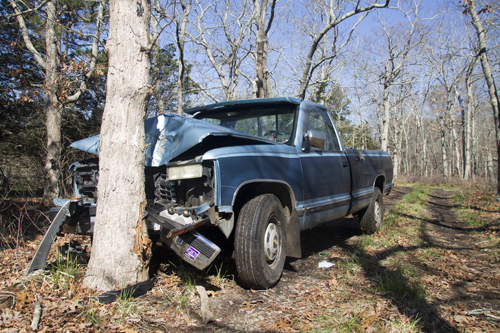On Monday morning, the crashed truck of Ronald Diachun still remained crunched into the tree he hit while fleeing to get help Saturday night. (Credit: Paul Squire)