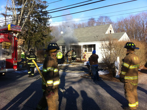 CARRIE MILLER | Firefighters at the scene of a basement fire on Kay Road in Calverton.
