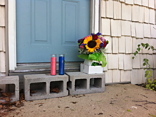 Flowers and candles were laid in the doorway of Ms. Bradstreet's home. (Credit: Carrie Miller photo)