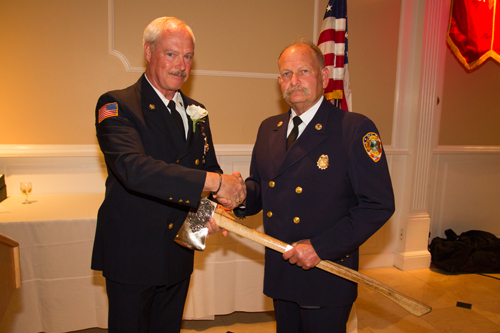 Chief Sean McCabe (left) shakes hands with Firefighter of the Year award-winner Howard Waldman (Credit: Jamesport Fire Department)