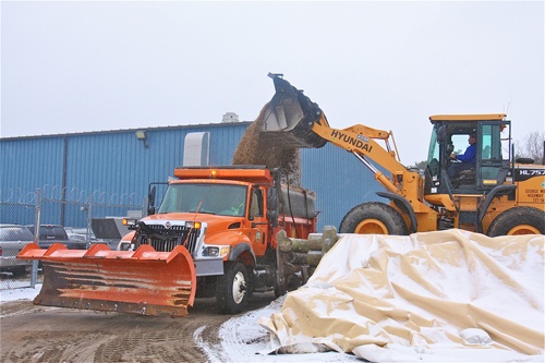 BARBARAELLEN KOCH PHOTO | Highway department assistant superintendent Mark Gajowski loads a truck up with sand/salt mixture at the highway department yard Thursday morning.