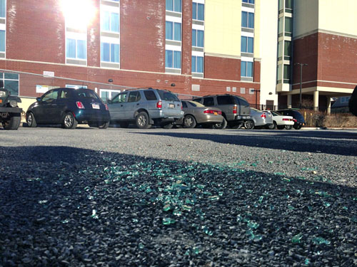 PAUL SQUIRE PHOTO | Glass on the rear parking lot behind the Treasure Cove Marina and Hyatt Hotel.