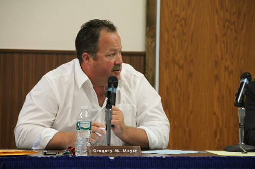 PAUL SQUIRE PHOTO | Riverhead school board vice president Greg Meyer calls for a vote on the NJROTC resolution during Tuesday night's meeting.