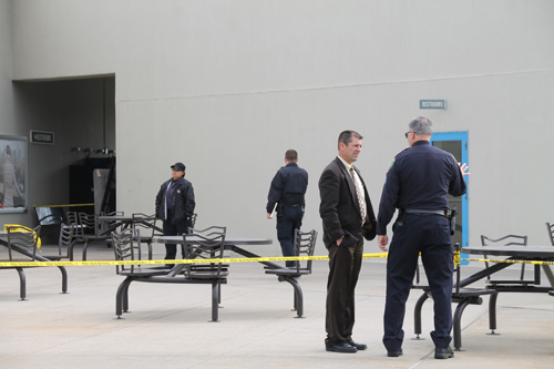 PAUL SQUIRE PHOTO | Riverhead police officers investigate where a woman was allegedly attacked at Tanger Outlet Center.