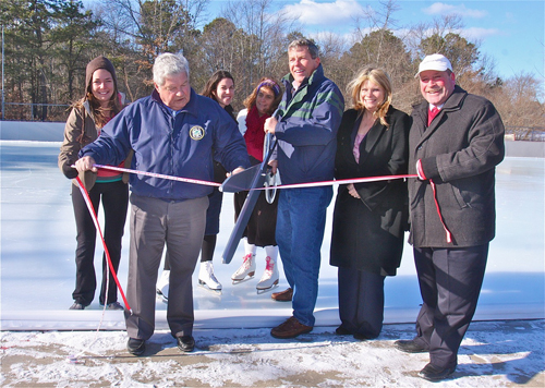 BARBARAELLEN KOCH PHOTO  |  Town board members (from left) John Dunleavy, George Gabrielsen, Jodi Giglio and Jim Wooten officially open the rink Thursday afternoon.
