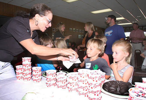 BARBARAELLEN KOCH PHOTO | Riverhead teacher Shirley Hill giving out ice cream to kindergartners Wednesday at the Jamesport firehouse.