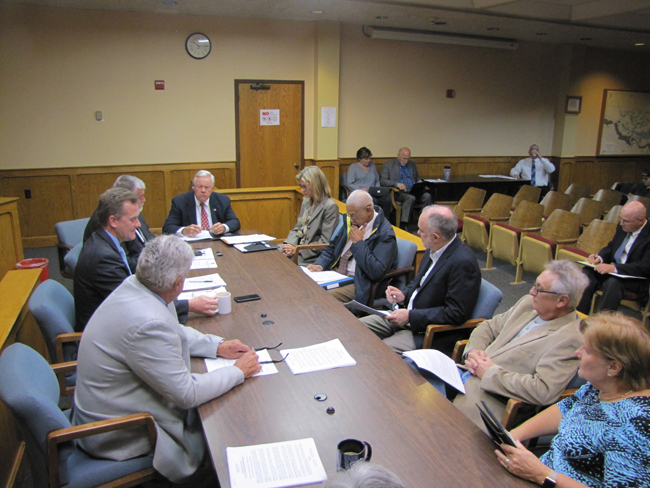 Riverhead's Independent Audit Committee members discuss a building department audit with Town Board members Thursday.