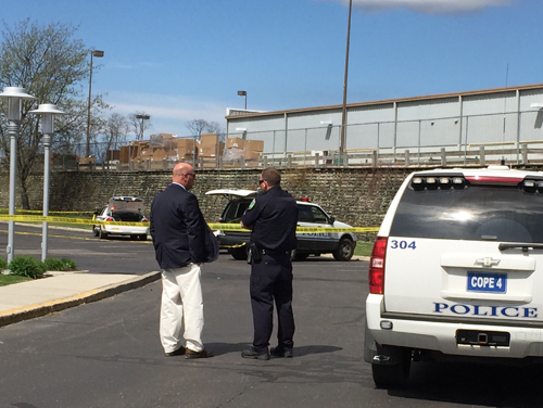 Police said a woman attacked another woman in a hotel parking lot on Friday afternoon. (Credit: Paul Squire)