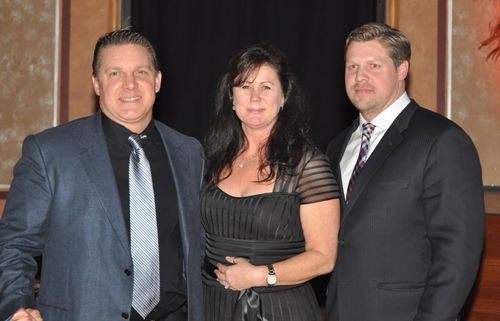 PAUL SQUIRE PHOTO | Timothy Stevens and Edward Harmes of Island International Industries with award presenter Tracy James.