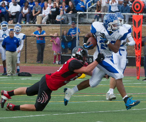 ROBERT O'ROURK PHOTO  |  Riverhead senior Jeremiah Cheatom powered the Blue Waves' offense on the ground Saturday against Newfield.