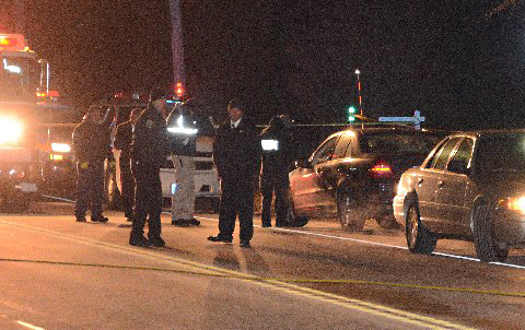 Police investigate the scene of the fatal accident Tuesday night. (Credit: AJ Ryan/Stringer News)