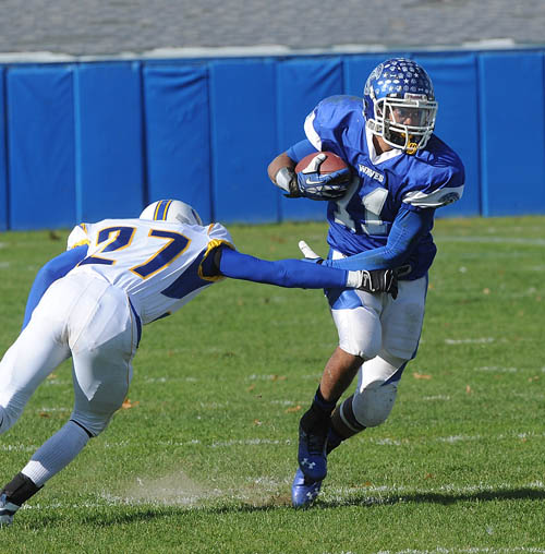 ROBERT O'ROURK PHOTO | Riverhead's Jaron Greenidge runs with the ball against West Islip during Saturday's football game.