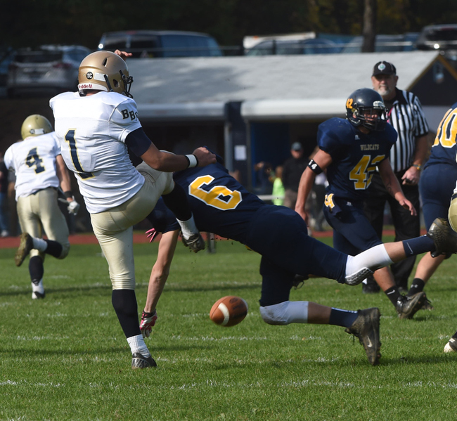 Jason Curran blocks a Bayport punt to help set up Shoreham's first touchdown Saturday. (Credit: Robert O'Rourk)