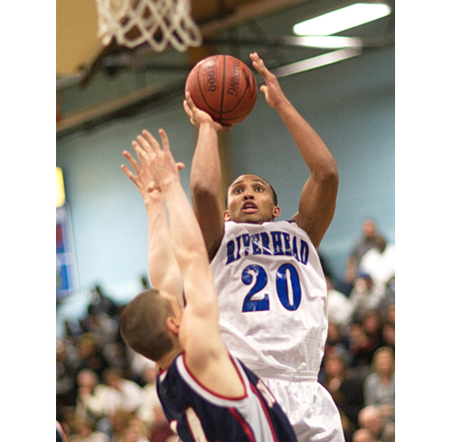 GARRET MEADE PHOTO  |  Riverhead junior Jeremiah Cheatom rises for a short jumper.