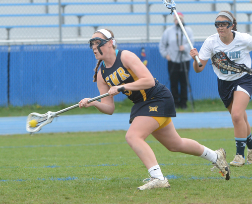 Jess Angerman led Shoreham-Wading River into the county finals last year. Now she's excelling at the University of Michigan. (Credit: Robert O'Rourk)