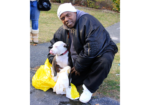 JENNIFER GUSTAVSON PHOTO  |  Joe Coffey with his dog that was rescued from the fire.