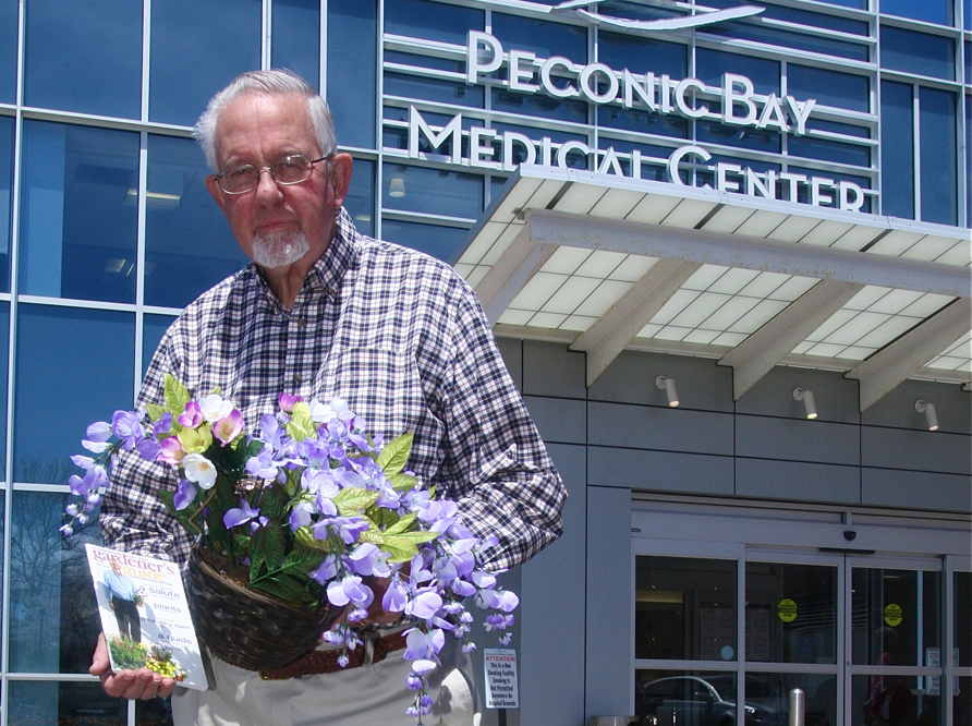 Joe Van de Wetering, the Garden Festival's founder, outside Peconic Bay Medical Center on Friday. (Credit: Barbaraellen Koch)