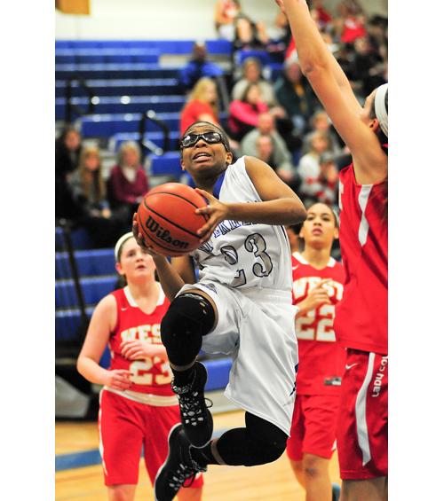 Riverhead guard Faith Johnson-DeSilvia drives to the basket Thursday against Hills West. (Credit: Bill Landon)
