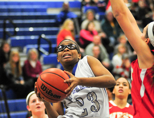 Riverhead guard Faith Johnson-DeSilvia drives to the basket against Hills West earlier this season. (Credit: Bill Landon, file)