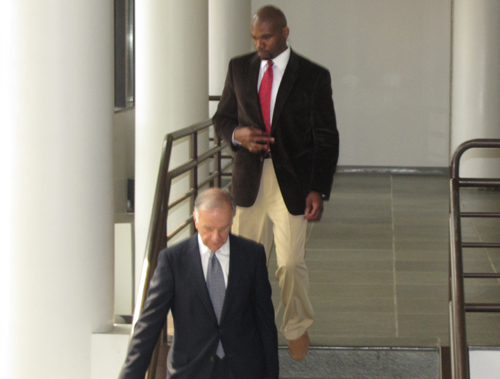 Joe Johnson (top) leaves court in 2012 with a lawyer. (Credit: Tim Gannon, file)