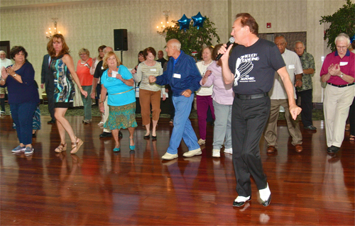 Alfonso Triggiani of Westhampton Beach teaching the 'Electric Slide' to joint replacement patients. (Credit: Barbaraellen Koch)