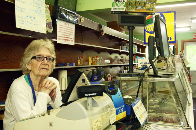 Juanita Devlin behind the cash register at her store Thursday morning. (Credit: Barbaraellen Koch)